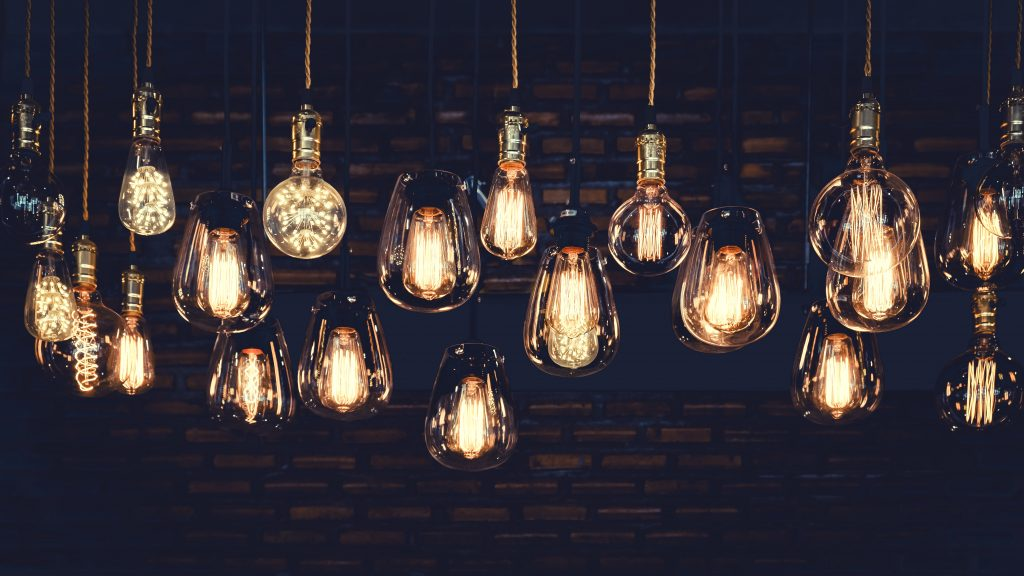 Image of vintage light bulbs glowing softly in a darkened room
